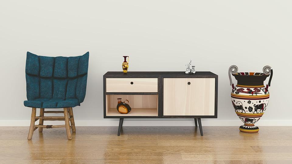 Ensemble de meubles pour la décoration : fauteuil, commode et vase